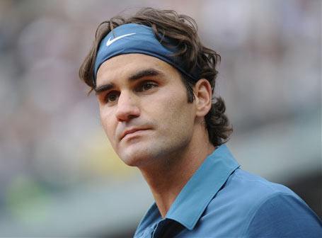 Federer và Soderling (áo trắng) sau trận tứ kết hôm qua.