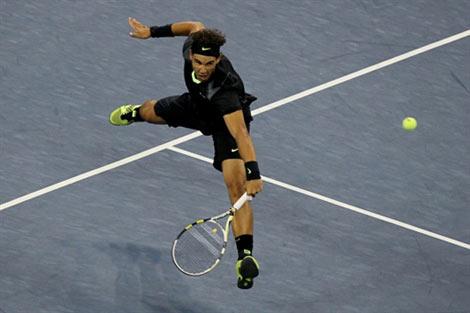 Rafael Nadal trong trận tứ kết. Ảnh: AFP.