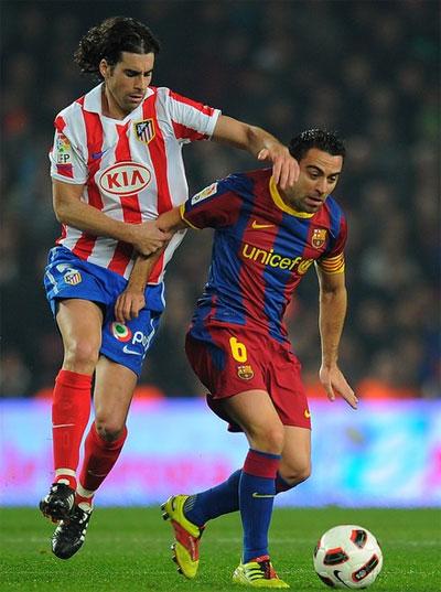 Atletico Madrid gần như bất lực nhìn Barca chơi bóng trong phần lớn thời gian. Ảnh: AFP.