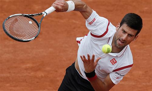 Djokovic, Nadal vào sách kỷ lục khi thắng ở vòng hai Pháp Mở rộng