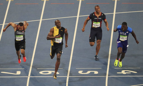 bolt-lan-thu-ba-gianh-hc-vang-olympic-chay-100m