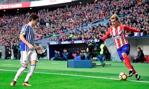 Griezmann ghi bàn muộn, Atletico thu hẹp khoảng cách với Barca