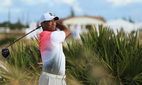 Tiger Woods trở lại sớm hơn dự kiến tại Farmers Insurance Open. Anh đặt mục tiêu dự tối đa số giải PGA Tour có thể trong năm 2018. Ảnh: Reuters.