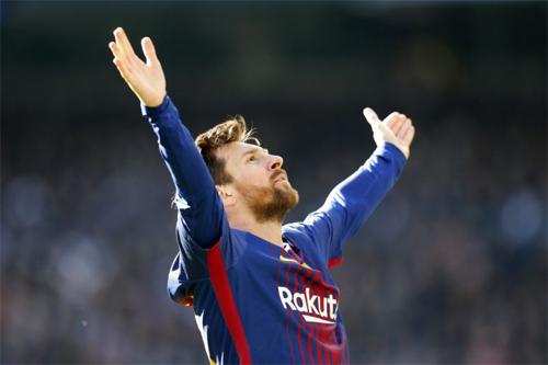 Messi chia vui sau khi ghi bàn trong trận El Clasico. Ảnh: Reuters