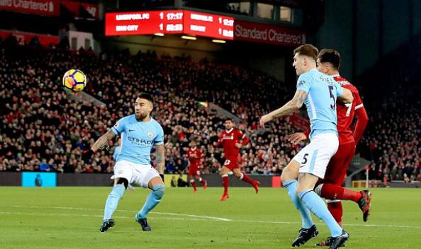 Cú lốp bóng đẳng cấp của Firmino mở màn cho 10 phút điên rồ của Liverpool trong hiệp hai. Ảnh: PA.
