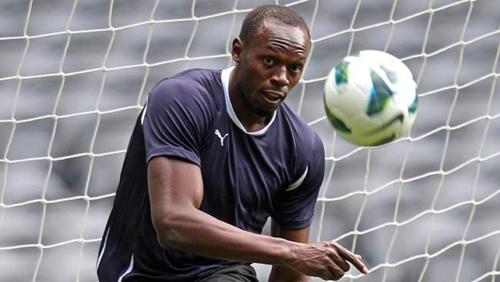 Usain Bolt là fan của Man Utd. Ảnh: Reuters.