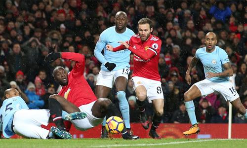 Man City nhiều khả năng đăng quang nếu đánh bại Man Utd ở trận đấu vào ngày 7/4. Ảnh: Reuters.