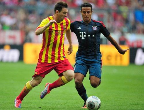 Thiago (phải) đóng vai trò trụ cột của Bayern sau khi rời Barca. Ảnh: Reuters