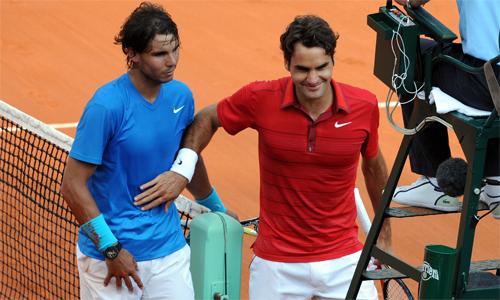 Federer hy vọng sẽ có dịp tái đấu Nadal trên mặt sân đất nện. Ảnh: AFP.