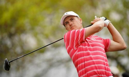 Jordan Spieth có vòng mở màn suôn sẻ dù thời tiết không thuận lợi. Ảnh: Reuters.