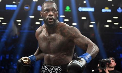 Wilder sẵn sàng đến Anh thống nhất đai vô địch với Joshua