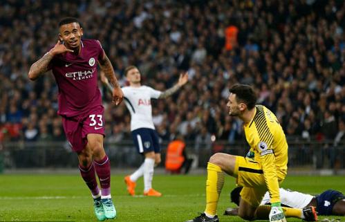 Tottenham không thể ngăn bước Man City lên ngôi thêm một vòng đấu. Ảnh:AFP.