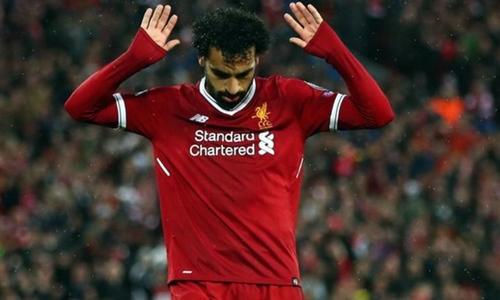 Salah không mừng bàn thắng khi xé lưới đội bóng cũ Roma. Ảnh: Reuters.
