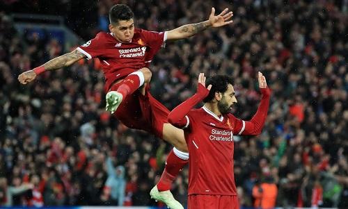 Firmino và Salah đều đã ghi 10 bàn ở Champions League mùa này. Ảnh: PA.