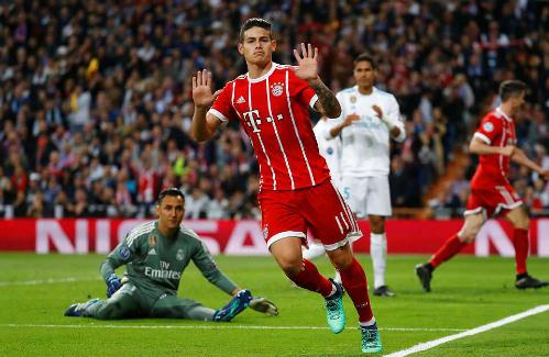 James Rodriguez đẩy kịch tính lên cao với bàn gỡ hòa 2-2. Ảnh: Reuters.