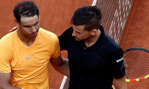 Nadal bất lực trước sự thăng hoa của Thiem. Ảnh: EFE.