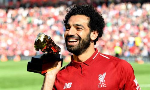 Salah nhận danh hiệu Vua phá lưới Ngoại hạng Anh sau trận đấu với Brighton. Ảnh: AFP.