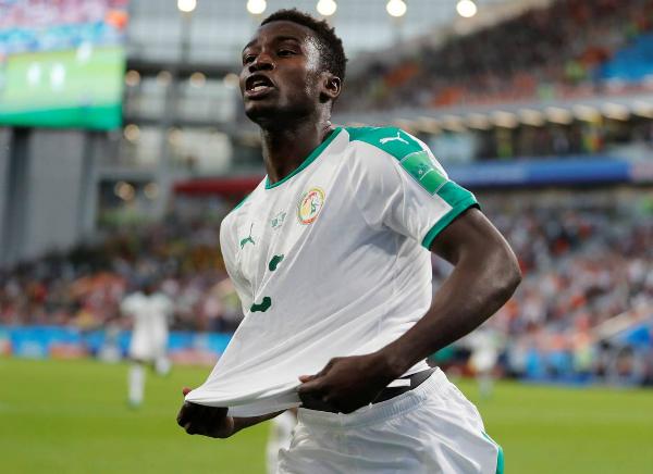 Wague trở thành cầu thủ châu Phi trẻ nhất ghi bàn tại World Cup. Ảnh: EPA, Reuters,