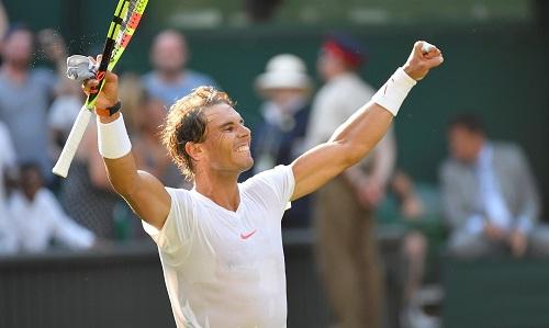 Nadal tiếp tục có 1 trận thắng tiện dụng ở Wimbledon 2018. Ảnh: Reuters.