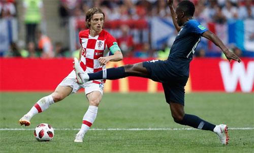 Modric (trái) là cầu thủ chơi hay nhất tại World Cup vừa qua. Ảnh: Reuters