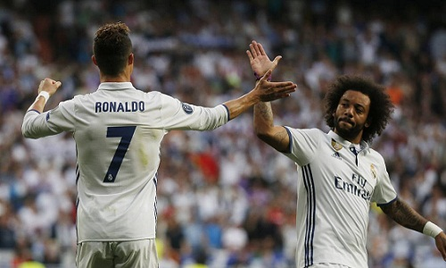 Ronaldo và Marcelo đã thi đấu cùng nhau nhiều năm tại Real. Ảnh: Reuters.