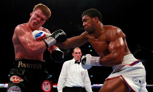 Bung sức tấn công đối thủ ở hiệp 7, Joshua giành chiến thắng knock-out thứ 21 trong sự nghiệp. Ảnh: Reuters.