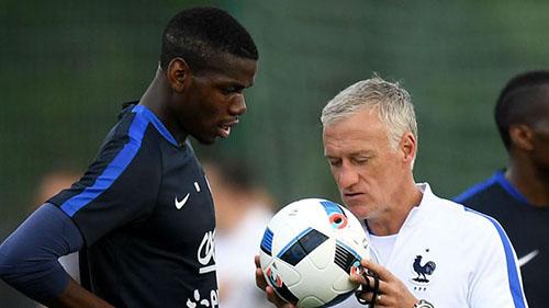 Pogba (trái) phát huy được hết khả năng tại World Cup 2018, dưới sự dẫn dắt của Deschamps. Ảnh: Reuters.