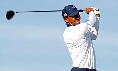 Tiger Woods chơi nỗ lực nhưng không đủ để giúp tuyển Mỹ giành chiến thắng ở loạt trận fourball. Ảnh: USA Today.