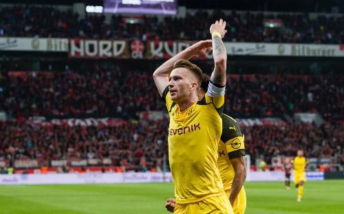 Marco Reus ghi dấu giày vào hai bàn giúp Dortmund gỡ hòa chỉ trong bốn phút. Ảnh: AFP.