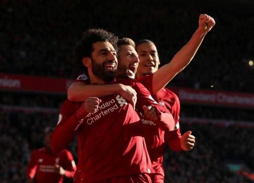 Salah và đồng đội mừng Liverpool lập thành tích cao bậc nhất lịch sử CLB. Ảnh: Reuters.