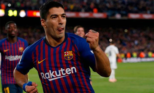 Suarez ghi danh vào nhóm những cầu thủ lập hat-trick tại El Clasico. Ảnh: Reuters