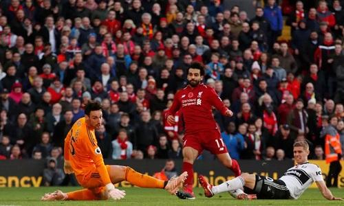 Salah trừng phạt Fulham trong một pha phản công chớp nhoáng. Đây là bàn thứ 6 của tiền đạo người Ai Cập tại Ngoại hạng Anh mùa này. Ảnh: Reuters.