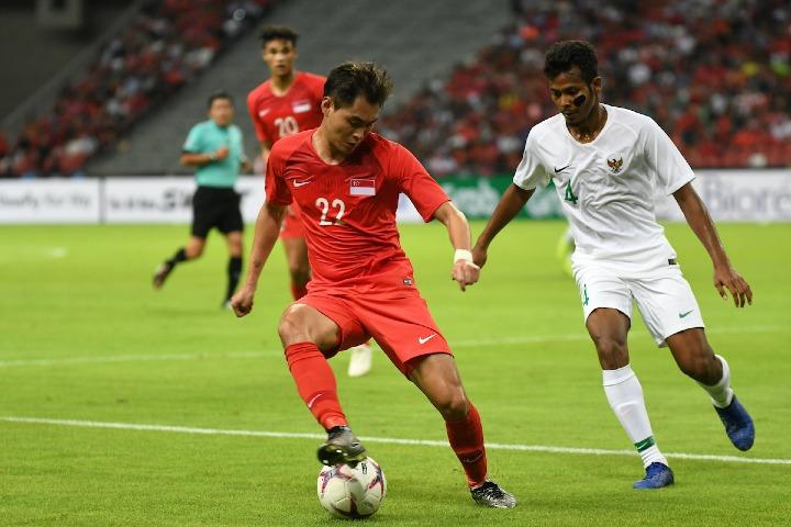 Singapore (áo đỏ) hứa hẹn còn gây bất ngờ tại giải. Ảnh: AFF.