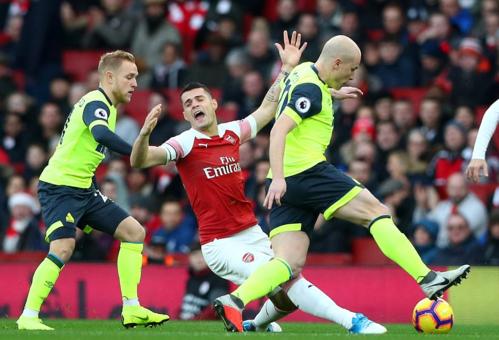 Arsenal không có được nhịp độ tốt trận này. Ảnh: Reuters.