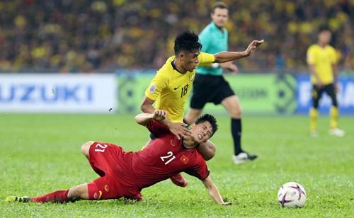Mất Đình Trọng (áo đỏ) là tổn thất không nhỏ với Việt Nam ở Asian Cup 2019. Ảnh: Lâm Đồng.
