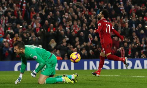 Salah ghi bàn thắng thứ 12 ở Ngoại hạng Anh mùa này. Ảnh: Reuters.