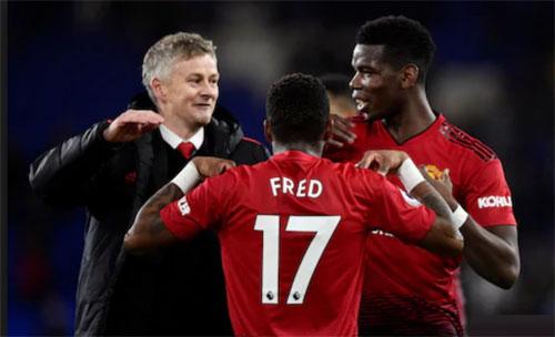 Sự xuất hiện của Solskjaer mang tới niềm vui cho Pogba và Man Utd. Ảnh: AFP.