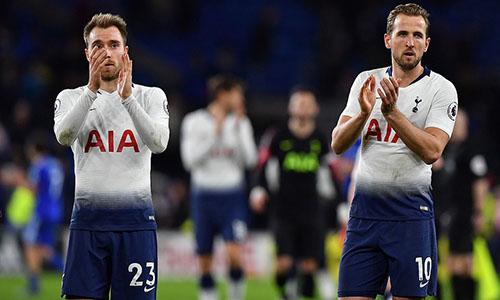 Eriksen (trái) và Kane cùng ghi bàn giúp Tottenham chiến thắng. Ảnh: AP.