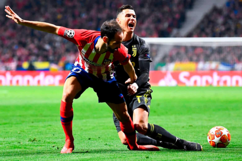 Ronaldo bất lực trước Atletico trong lần đầu tiên trở về thi đấu tại Madrid. Ảnh: AFP.