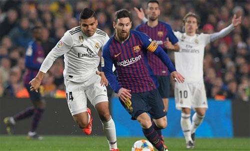 Real một lần nữa cần khóa chặt Messi. Ảnh: Reuters