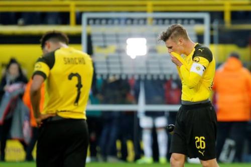 Dortmund hòa ba và thua một ở năm vòng gần nhất tại Bundesliga. Ảnh:Reuters.