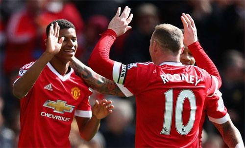 Rooney và Rashford từng có thời gian thi đấu cùng nhau tại Man Utd. Ảnh: Reuters