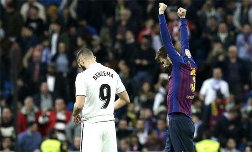 Pique và Barca thắng cả hai trận trên sân Bernabeu mùa này. Ảnh: Reuters