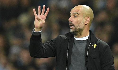 Guardiola sẽ đi vào lịch sử bóng đá Anh nếu giành cú ăn bốn. Ảnh: AFP.
