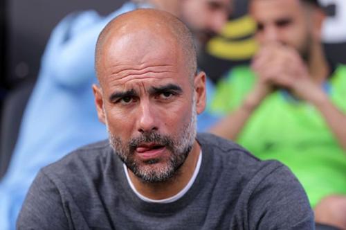 Guardiola từng giành cú ăn ba ở Barca. Ảnh:AFP.