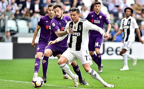 Juventus gặp nhiều khó khăn nhưng cũng hoàn thành mục tiêu ba điểm trước Fiorentina. Ảnh: Reuters.