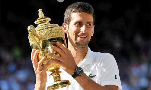 Djokovic nhận 2,86 triệu đôla tiền thưởng cho chức vô địch Wimbledon 2018. Ảnh: Reuters.