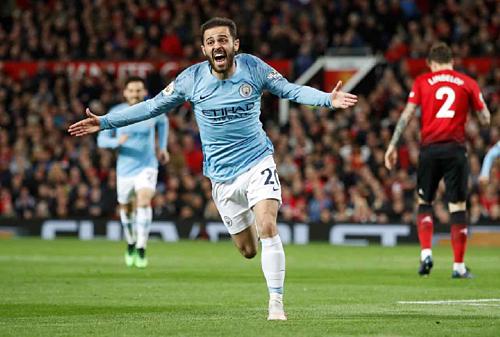 Man City (áo xanh) vượt Man Utd để trở thành CLB giá trị cao nhất Ngoại hạng Anh. Ảnh: Reuters.