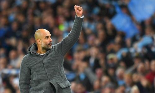 Guardiola giúp Man City thống trị bóng đá Anh với chức vô địch thứ hai liên tiếp. Ảnh: Reuters.