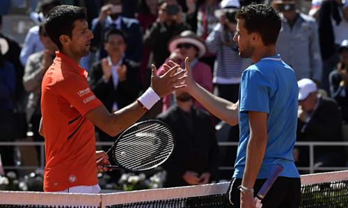 Djokovic (trái) lỡ giấc mộng giành Nole Slam.
